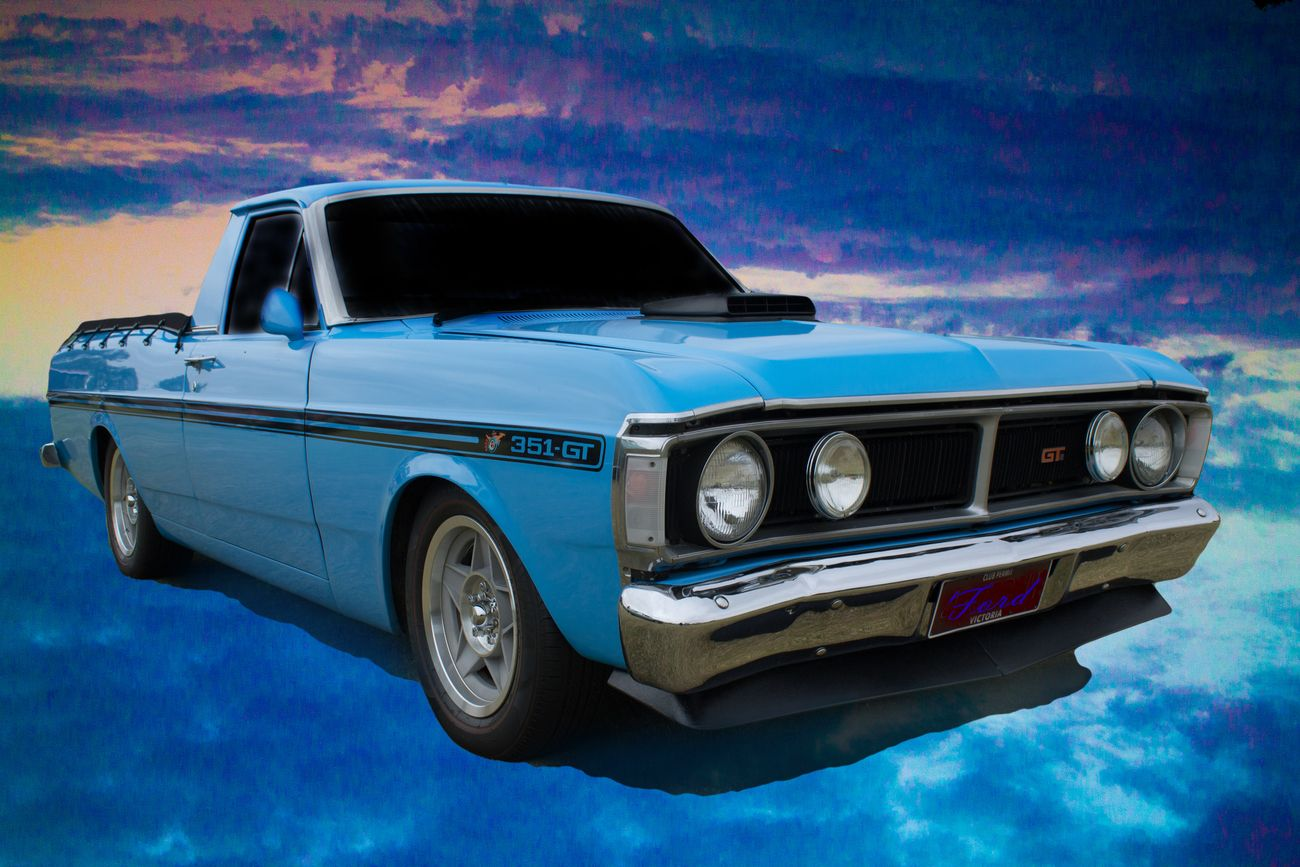 A beautiful GT Falcon Ute  Photoshopped onto a cloudscape that was shot in RAW which makes it easy to change the colors of the clouds.