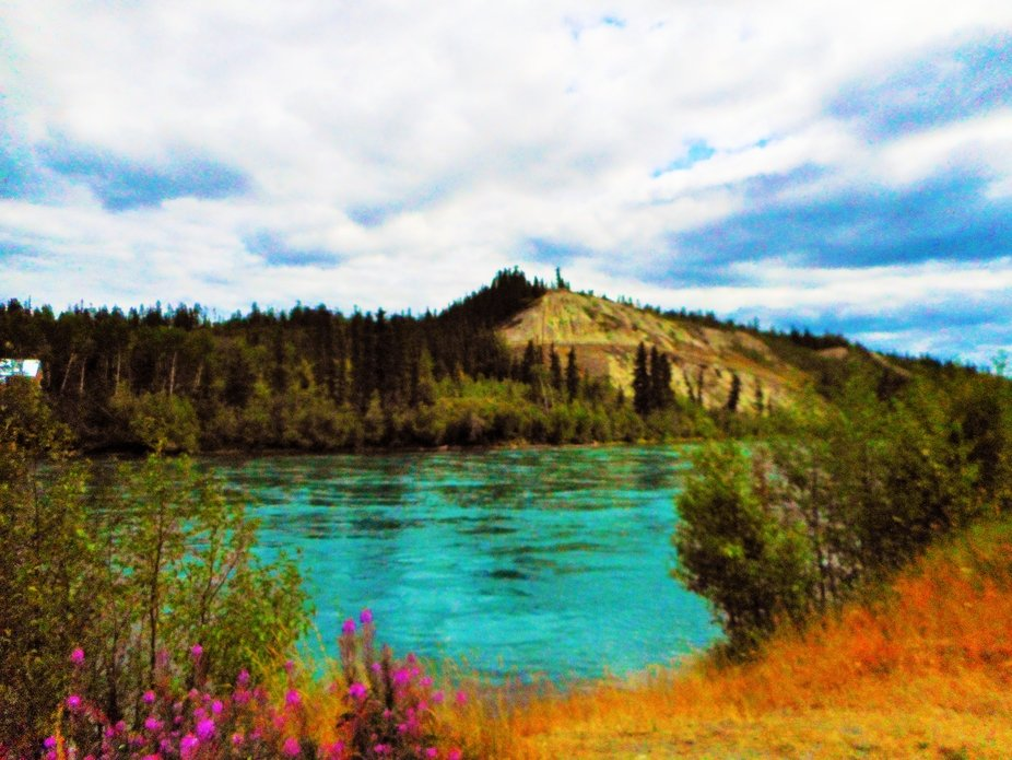Photograph is a picture of the Yukon River in Whitehorse, Yukon Territories, Canada