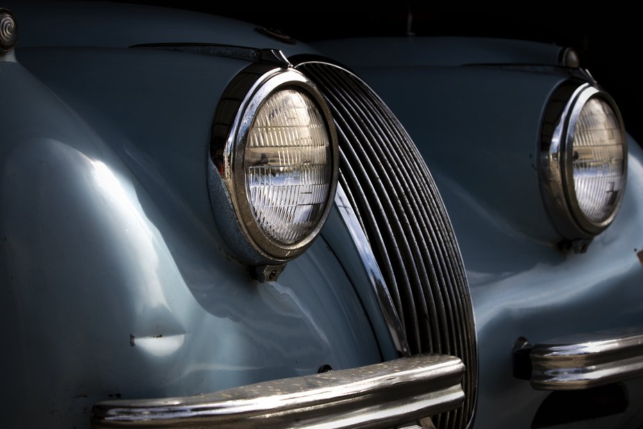 A 1954 Jaguar XK 120 resting quietly in a friend's garage.