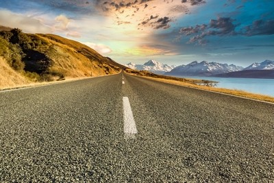 Low perspective view of the long straight road leading to the Aoraki National Park in the Southern Alps
