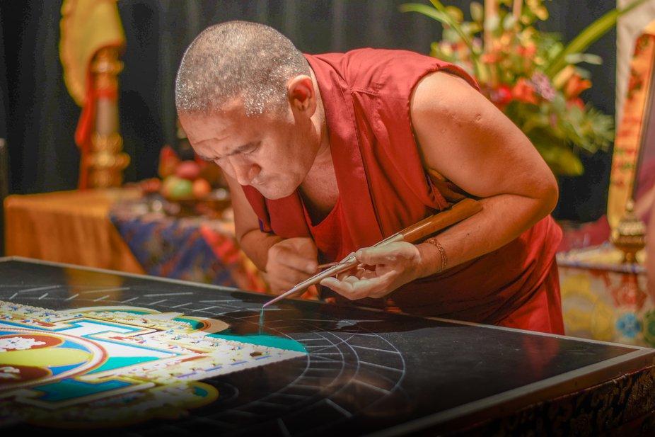 Buddhist Monk working on the Mandala
