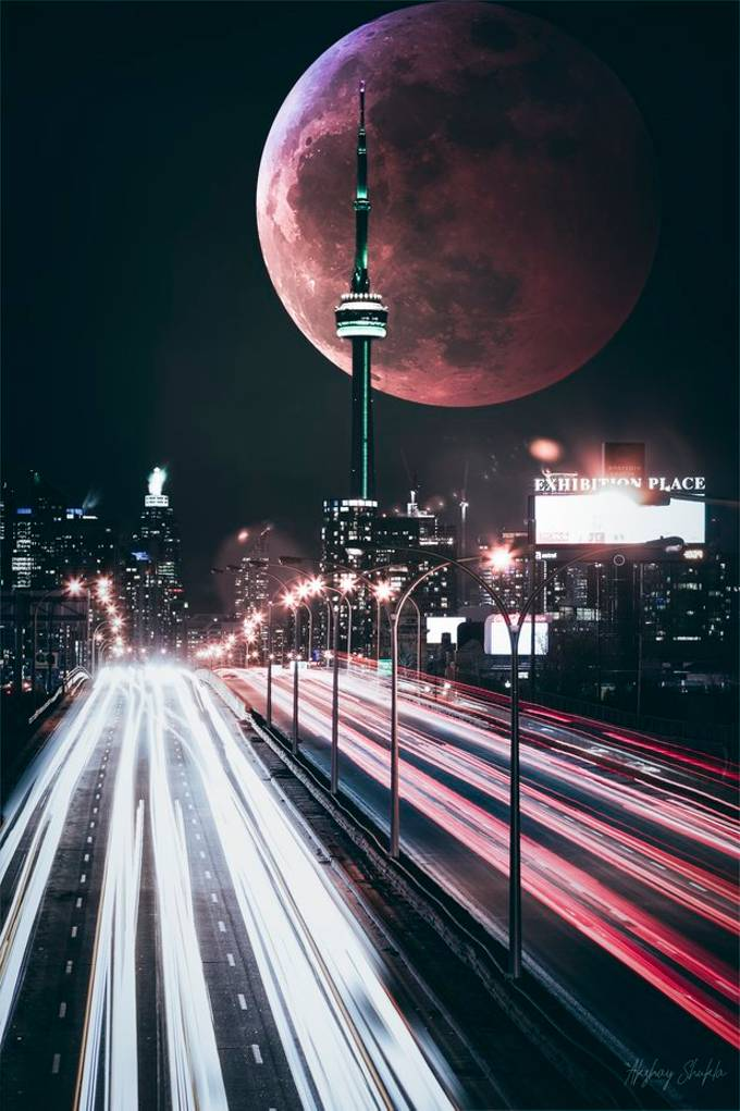 Last night went out braved the cold and managed to capture the city of Toronto at night with trails of car driving by and CN tower lit at night, decided to throw in a red moon in background in post processing just thought it looked better filling that negative space.