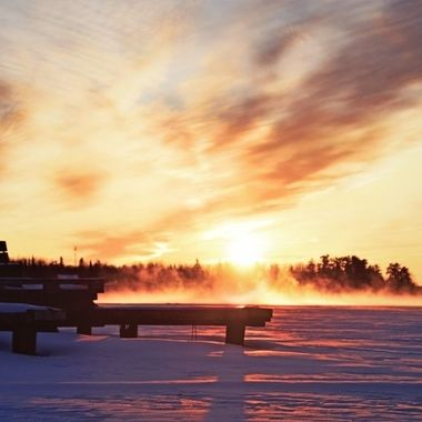 Shot this Sunset in Ranier at the rapids on upper Rainy River on a cold evening in January as the frost raised off the open water