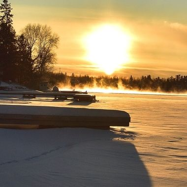 At well below zero Fahrenheit the frost rose off the open water catching the setting sun