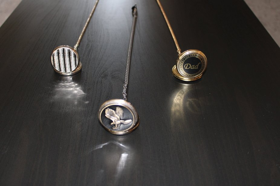 Three pocket watches running out of time
