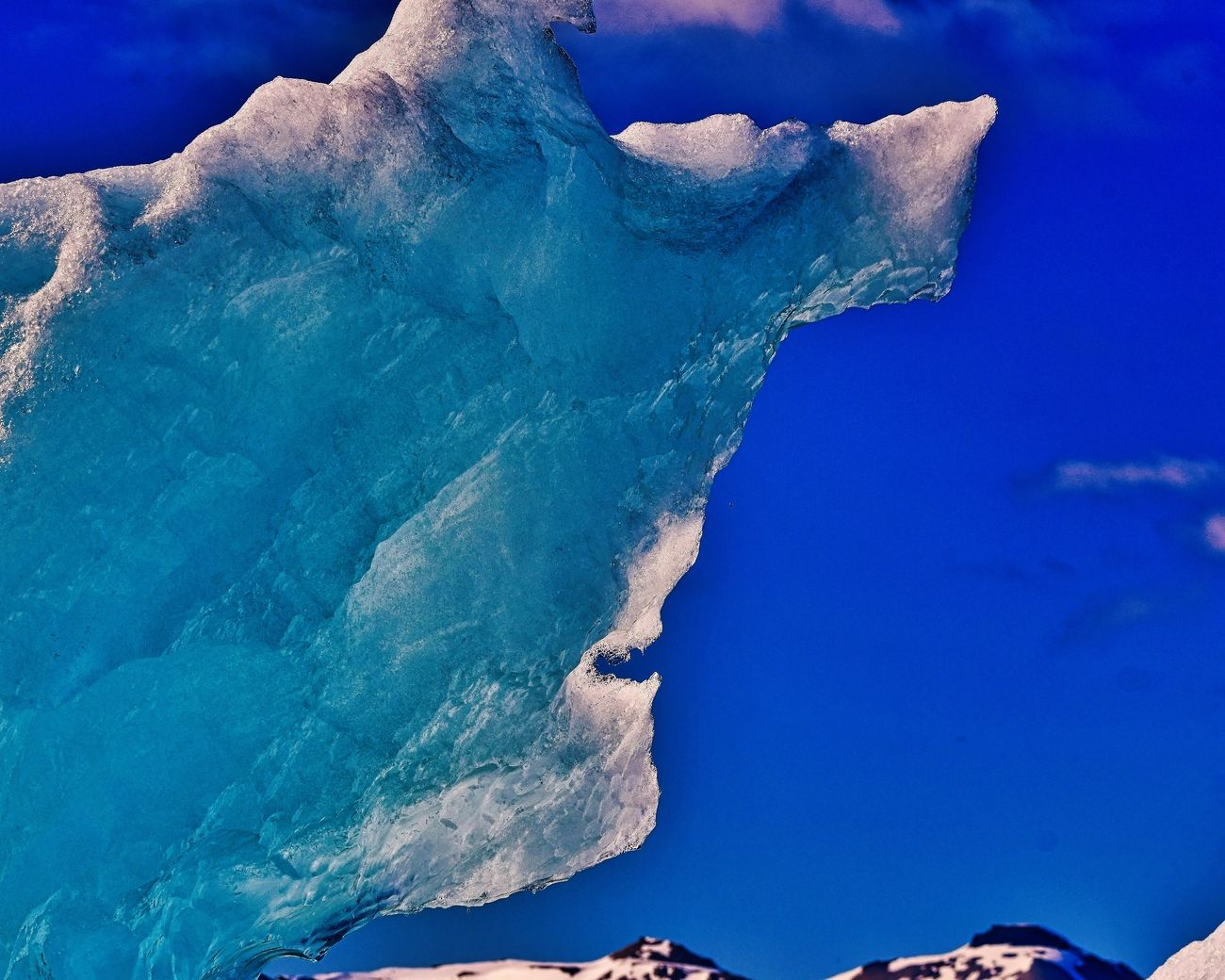 Ice man,  glacial ice melting in the sun.  Photo taken at the 14th July Glacier in Svalbard, Norway