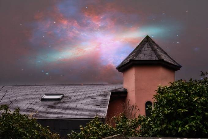 Scenic view of roof and galaxy over it