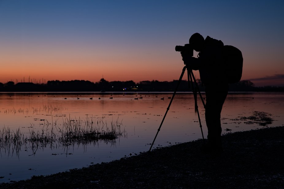 Silhouette of a photographer taking photos