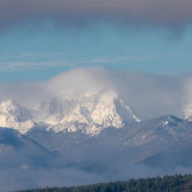 The Olympic Mountains, Mt. Constance showing her fresh fallen snow. Hood Canal, Washington, USA