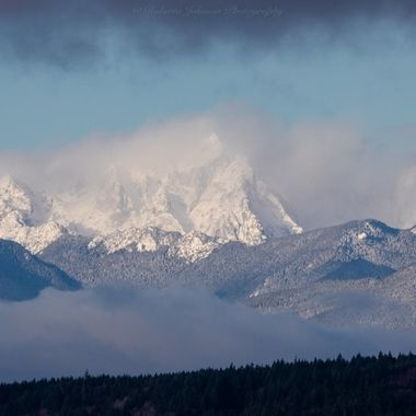 The Olympic Mountains, Mt. Constance showing her beauty with fresh fallen snow. Hood Canal, Washington, USA