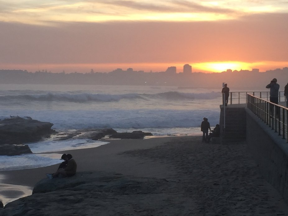 Walking along the beach during the sun set