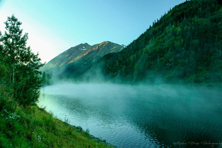 Mist rising off of an Alaskan lake.