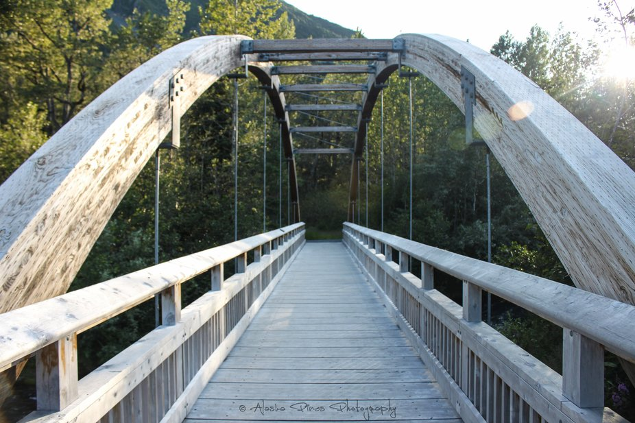 A short walking bridge over Portage Creek on a walking trail near the Portage Glacier, Alaska.
