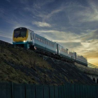 An evening train on an embankment
