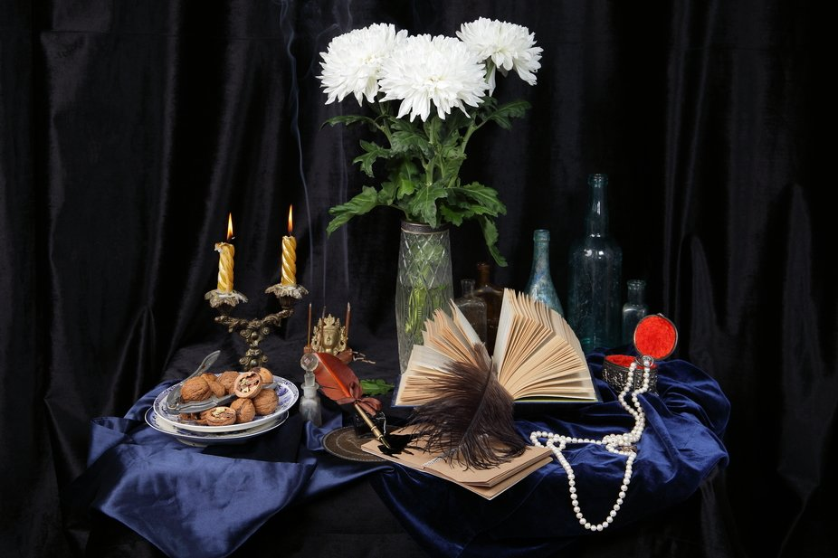 Still life in the Dutch style on the theme of aesthetic reading of paper books and writing paper ...