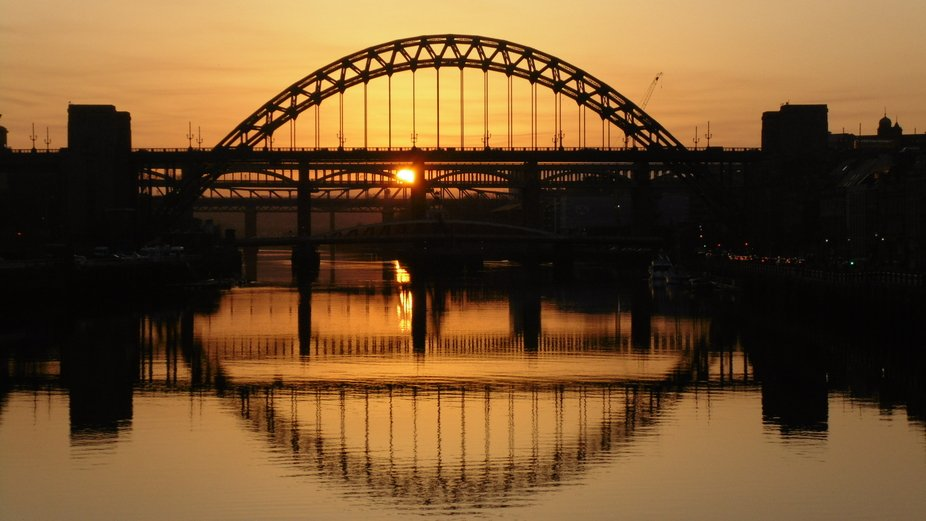 Tyne bridges and reflections at sunset.