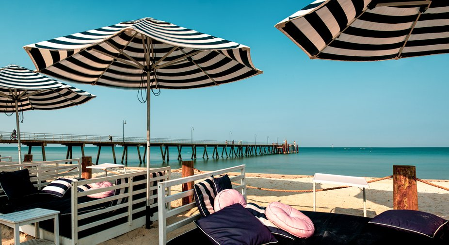 A day at the beach in Glenelg , Australia where the pillows are pink and the sand it brilliant wh...