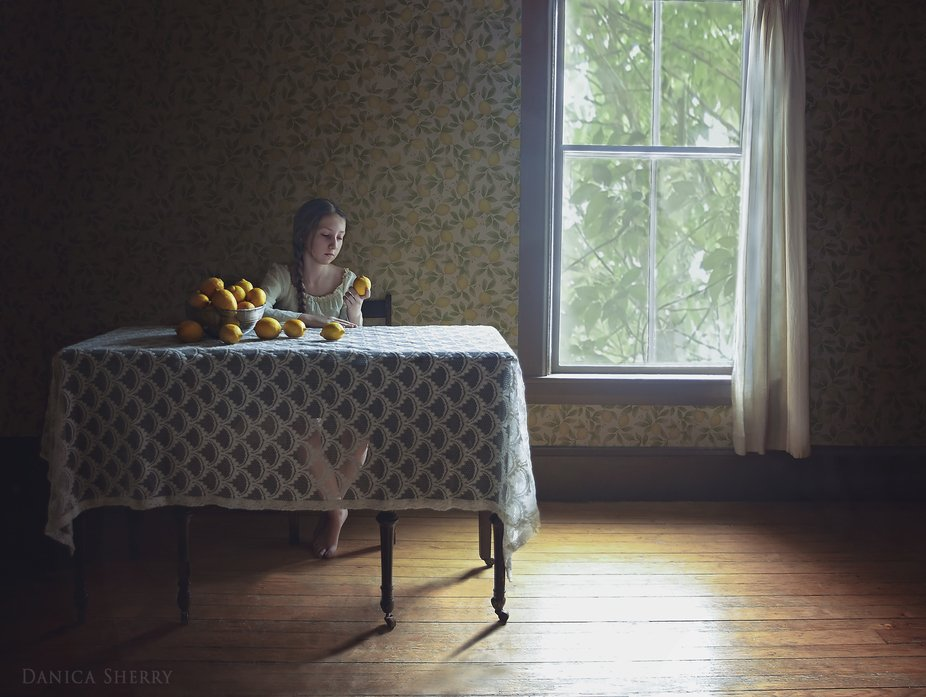 Portrait of Olivia, in her home with lemons, age thirteen.