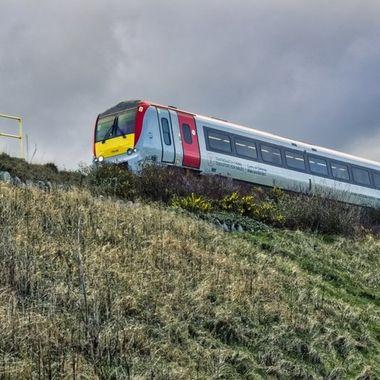 A train passing along an embankment.