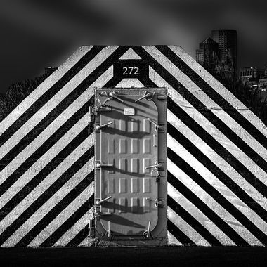 WWII concrete ammo bunker painted black & yellow The strips give the door a 3D look
