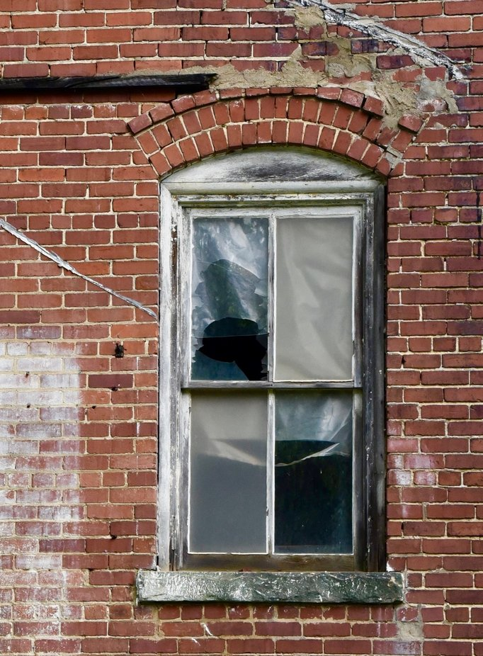 Broken Window in Brick Wall