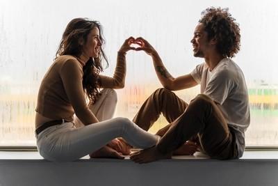 Couple in love in a window