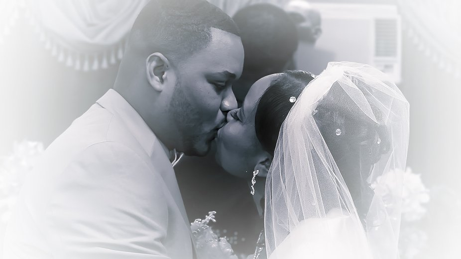 Closeup of bride and groom kissing.