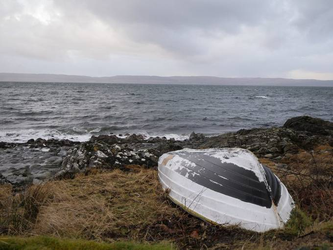Summer boat on the shoreline at Catacol, Isle of Arran.