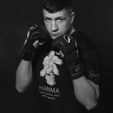 A Mixed Martial Arts fighter in Black and White