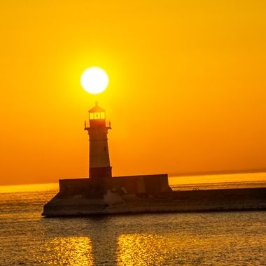 Sunrise over the Canal Park Lighthouse, Duluth, Minnesota on a cool clear February morning