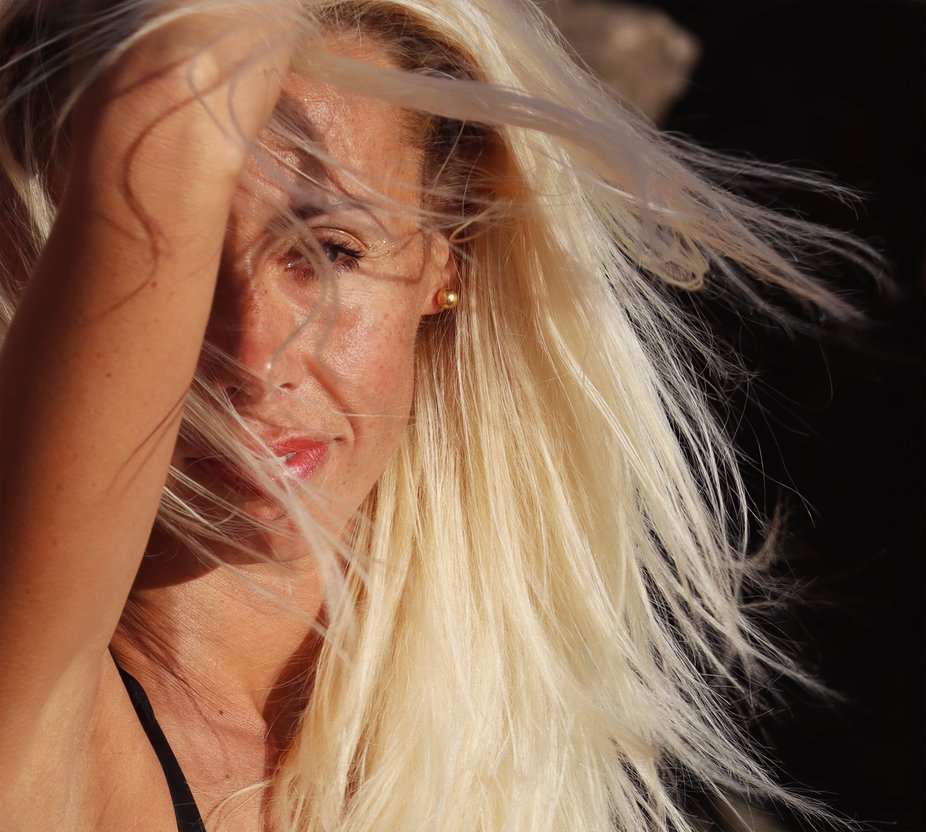 It was incredibly windy when we met at the beach to take some pictures. Her hair was flying every...