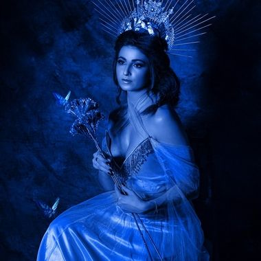 lady in blue and butterflies