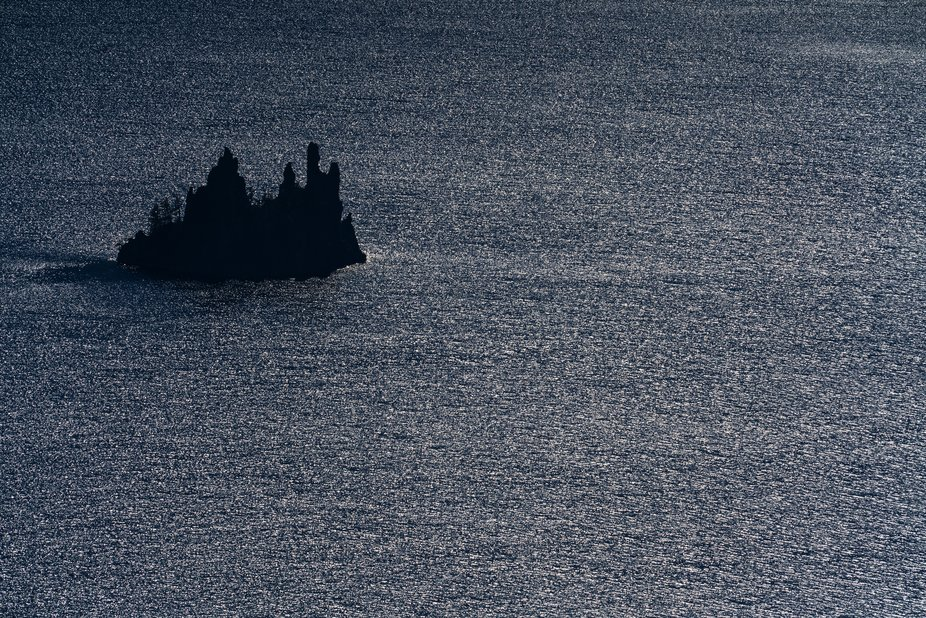 An early sunset on Crater Lake during wildfire season frames the famous Phanton Ship formation.