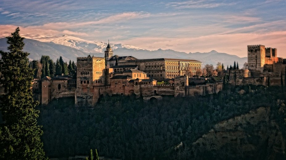 The Alhambra is a palace and fortress complex located in Granada, Andalusia, Spain.  It was origi...