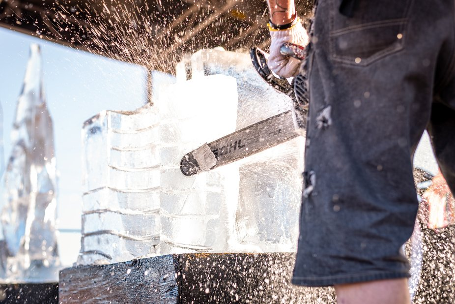 Carving ice by chain saw is dangerous work. But it is my #1 favorite thing to photograph