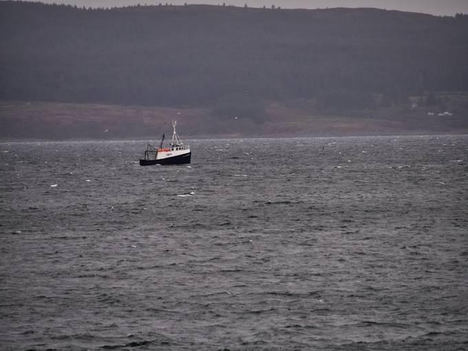 Fishermen inbetween the storms in the Kilbrannsn Sound.