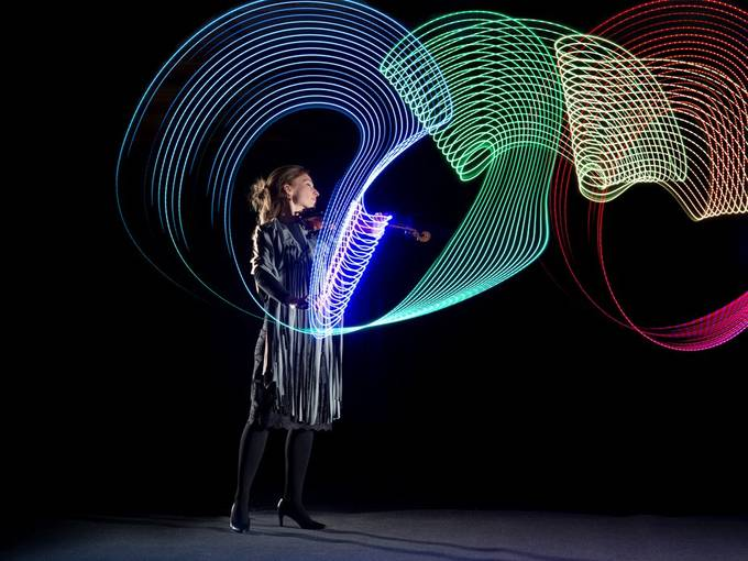Violinist with her visualised play. An LED strip was taped to the bow, the camera was panned during a long exposure in the dark. Flashes were fired on the second curtain.   20200120 127_1.JPG