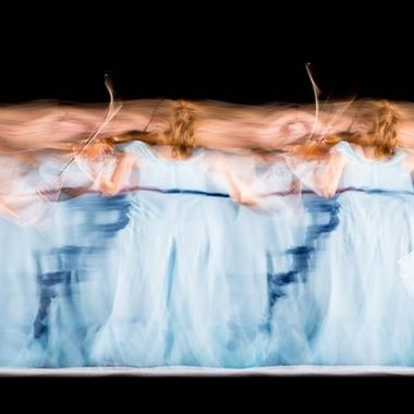 Violinist dancing and playing during a long exposure. 