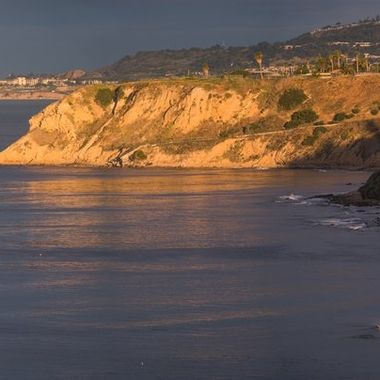 This is the view of the Southwest corner of the Palos Verdes Peninsula from Point Fermin reflecting the early morning sun light.  Many of us would come here early in the morning before sun rise to catch (photograph) the actions of peregrine falcon pair that lives in the nest below us in the cliffs.  Soon there will be fledglings of these falcons flying around the cliffs waiting and begging for food brought back by their parents.  They will learn to received their food in mid-air transfers.  However, there are slow mornings or activities are way below us in the cliffs.  Even so, the view like this one is worth our effort to get here early.  This photo was stitched together from 6 different full frame shots at 420 mm (300mm + 1.4 x).