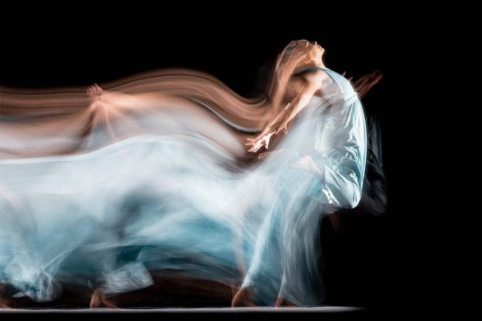 During a long exposure, the model moved between two strong honeycombed permanent lights, two honeycombed flashes were fired on the second curtain when she jumped. Model: @portfoliosandy 20200213 011 Sandy_2.JPG