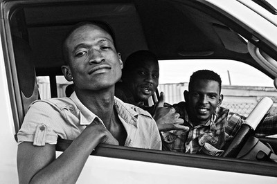 Who said taxi drivers don't like taking pictures? Surely that person lied because my friend here literally stopped, and asked to be photographed with his friends!