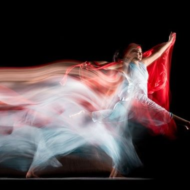 The dancer moved between two permanent lights during a long exposure. Two flashes were fired on the second curtain. 