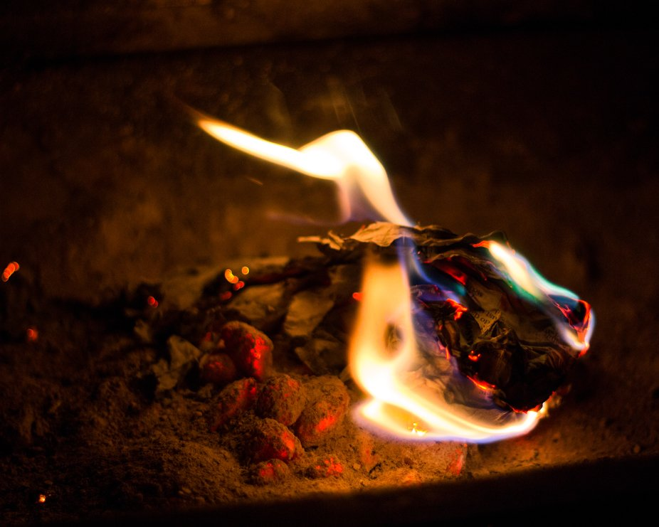 newspaper on fire on BBQ