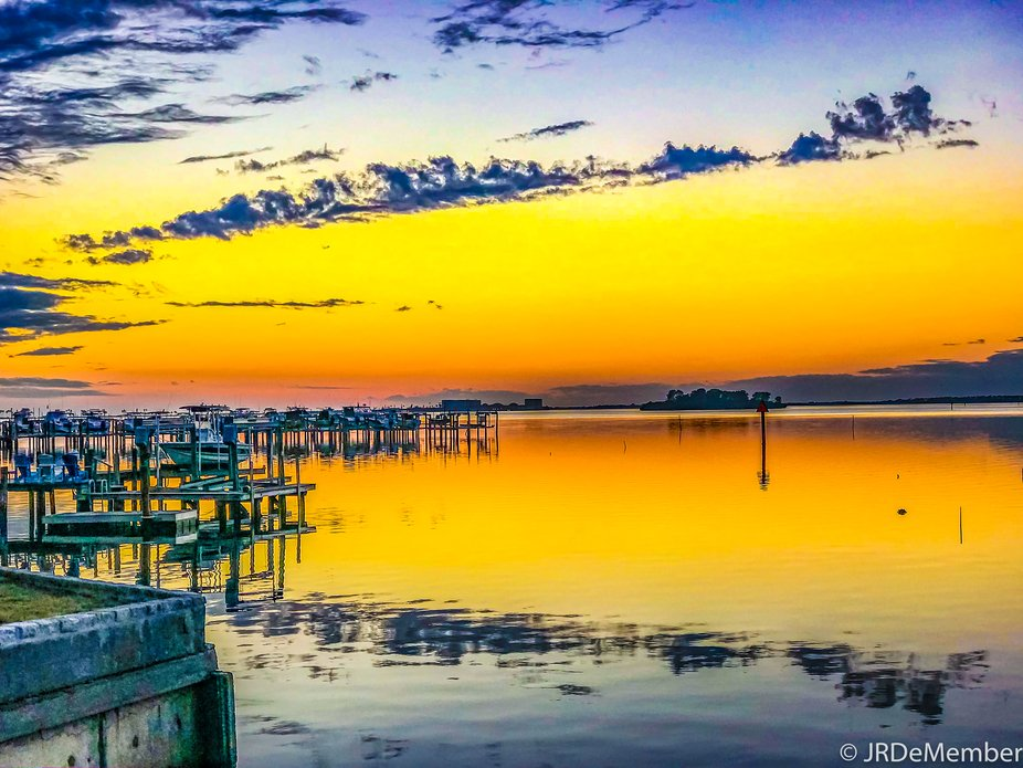A partly cloudy day in February at Speckled Trout Marina in Palm Harbor, Florida at dusk. The sti...