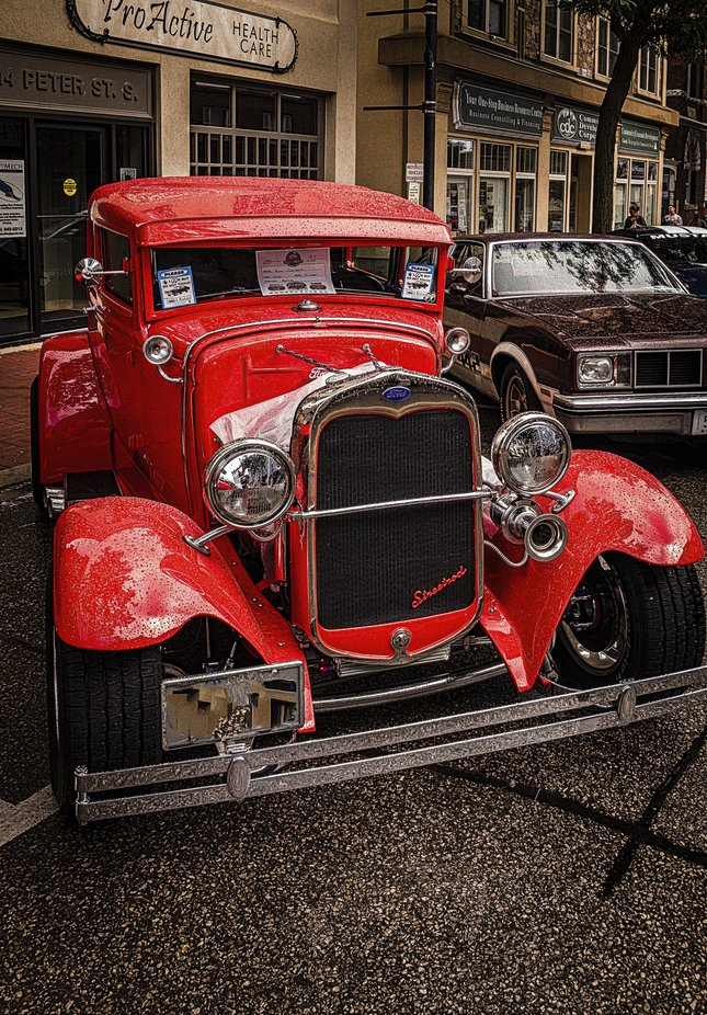 Show cased on the streets of a small town car show.
