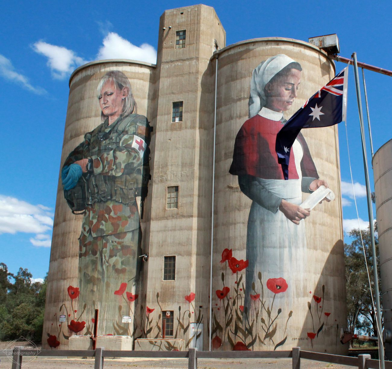 Painted silos at Devenish Victoria,the painting commemorates the role of Australian women in war from nurses of WW1 to the front line medics of today.