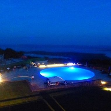 One of my projects using supple lighting to enhance the pool deck without spoiling the view of the lake