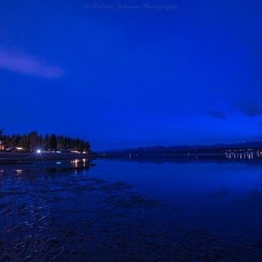 There is something so magical about the blue hour. The colors become so  intense and viviid to the eye. Hood Canal, Washington, USA