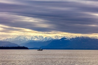 Tugboat And Mountains