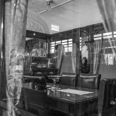 Capture of a dining car through the window - managed to capture the reflection of the steam engine in the background